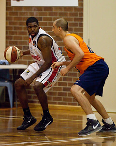 Dusty Rychart, Joevan Catron - Cairns Taipans v Wollongong Hawks - Sunshine State Challenge Pre-season NBL Basketball, Southport School, Gold Coast, Queensland, Australia; 22 September 2011. Photos by Des Thureson:  http://disci.smugmug.com.