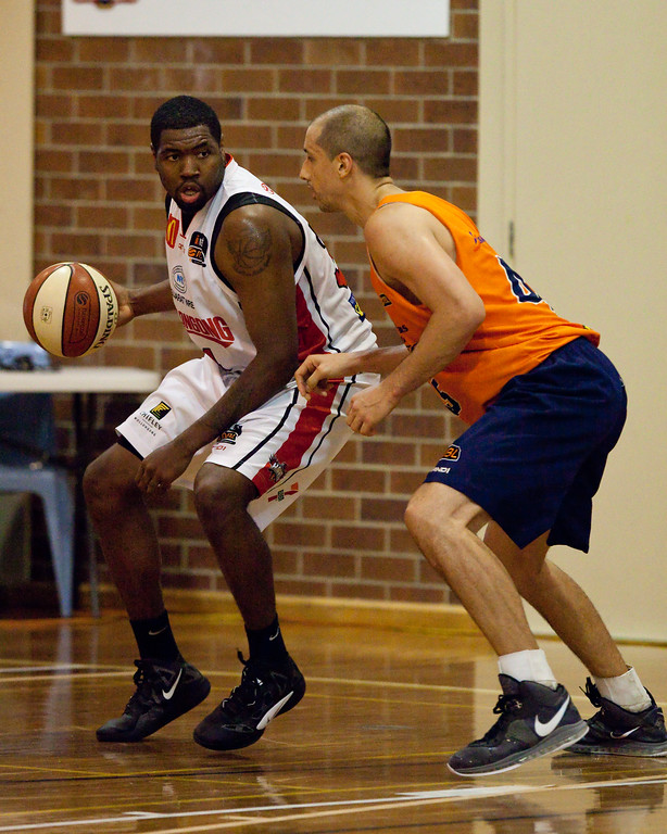 "Dusty Rychart, Joevan Catron - Cairns Taipans v Wollongong Hawks - Sunshine State Challenge Pre-season NBL Basketball, Southport School, Gold Coast, Queensland, Australia; 22 September 2011. Photos by Des Thureson:  <a href=""http://disci.smugmug.com"">http://disci.smugmug.com</a>."