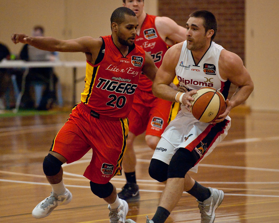 "Brad Robbins, Patty Mills - Melbourne Tigers v Perth Wildcats - Sunshine State Challenge Pre-season NBL Basketball, Southport School, Gold Coast, Queensland, Australia; 22 September 2011. Photos by Des Thureson:  <a href=""http://disci.smugmug.com"">http://disci.smugmug.com</a>."