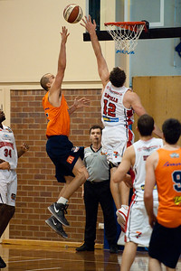 Dusty Rychart, Glen Saville - Cairns Taipans v Wollongong Hawks - Sunshine State Challenge Pre-season NBL Basketball, Southport School, Gold Coast, Queensland, Australia; 22 September 2011. Photos by Des Thureson:  http://disci.smugmug.com.