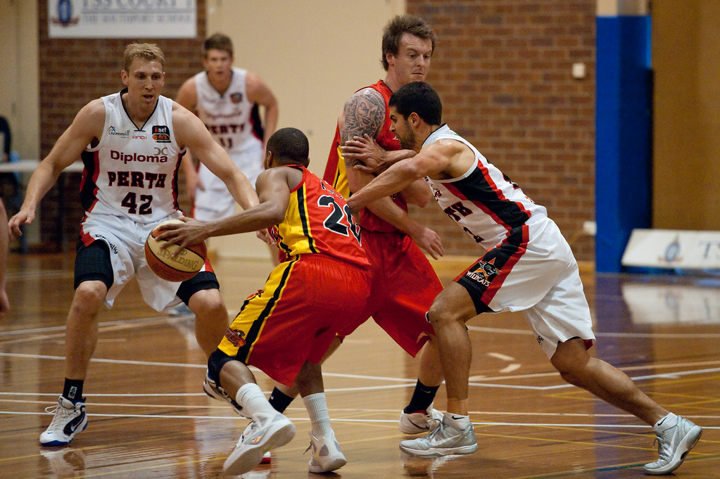 "Cam Tragardh screens Kevin Lisch - Melbourne Tigers v Perth Wildcats - Sunshine State Challenge Pre-season NBL Basketball, Southport School, Gold Coast, Queensland, Australia; 22 September 2011. Photos by Des Thureson:  <a href=""http://disci.smugmug.com"">http://disci.smugmug.com</a>."
