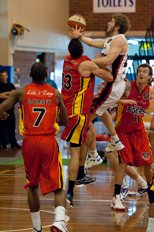 "Jesse Wagstaff - Melbourne Tigers v Perth Wildcats - Sunshine State Challenge Pre-season NBL Basketball, Southport School, Gold Coast, Queensland, Australia; 22 September 2011. Photos by Des Thureson:  <a href=""http://disci.smugmug.com"">http://disci.smugmug.com</a>."