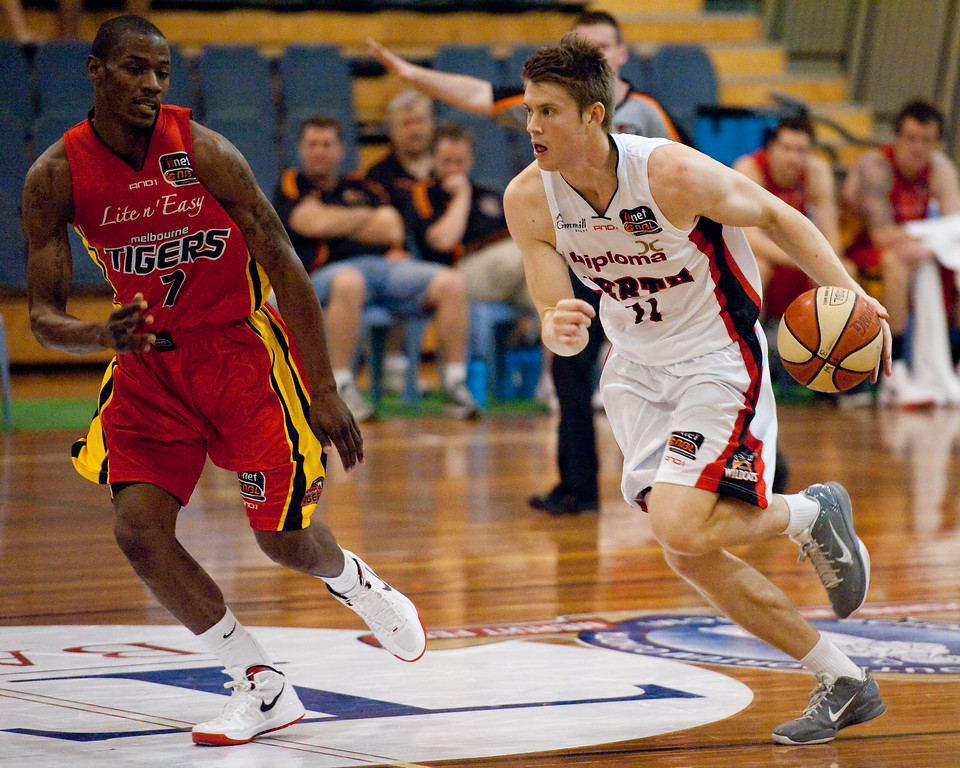 "Cam Tovey, Ron Dorsey - Melbourne Tigers v Perth Wildcats - Sunshine State Challenge Pre-season NBL Basketball, Southport School, Gold Coast, Queensland, Australia; 22 September 2011. Photos by Des Thureson:  <a href=""http://disci.smugmug.com"">http://disci.smugmug.com</a>."