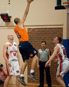 Dusty Rychart, Larry Davidson, David Gruber - Cairns Taipans v Wollongong Hawks - Sunshine State Challenge Pre-season NBL Basketball, Southport School, Gold Coast, Queensland, Australia; 22 September 2011. Photos by Des Thureson:  http://disci.smugmug.com.