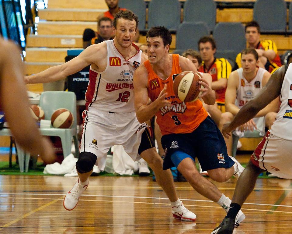 "Brad Hill, Glen Saville - Cairns Taipans v Wollongong Hawks - Sunshine State Challenge Pre-season NBL Basketball, Southport School, Gold Coast, Queensland, Australia; 22 September 2011. Photos by Des Thureson:  <a href=""http://disci.smugmug.com"">http://disci.smugmug.com</a>."