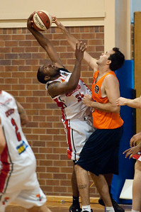 Joevan Catron, Ian Crosswhite - Cairns Taipans v Wollongong Hawks - Sunshine State Challenge Pre-season NBL Basketball, Southport School, Gold Coast, Queensland, Australia; 22 September 2011. Photos by Des Thureson:  http://disci.smugmug.com.