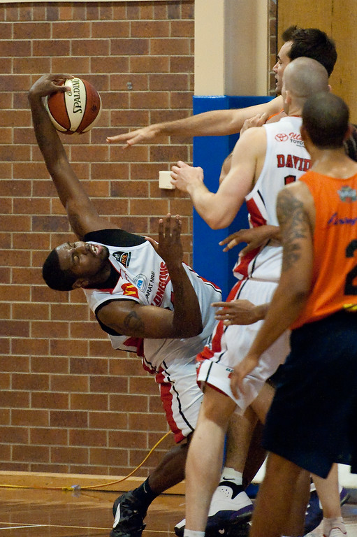 "Joevan Catron, Ian Crosswhite - Cairns Taipans v Wollongong Hawks - Sunshine State Challenge Pre-season NBL Basketball, Southport School, Gold Coast, Queensland, Australia; 22 September 2011. Photos by Des Thureson:  <a href=""http://disci.smugmug.com"">http://disci.smugmug.com</a>."