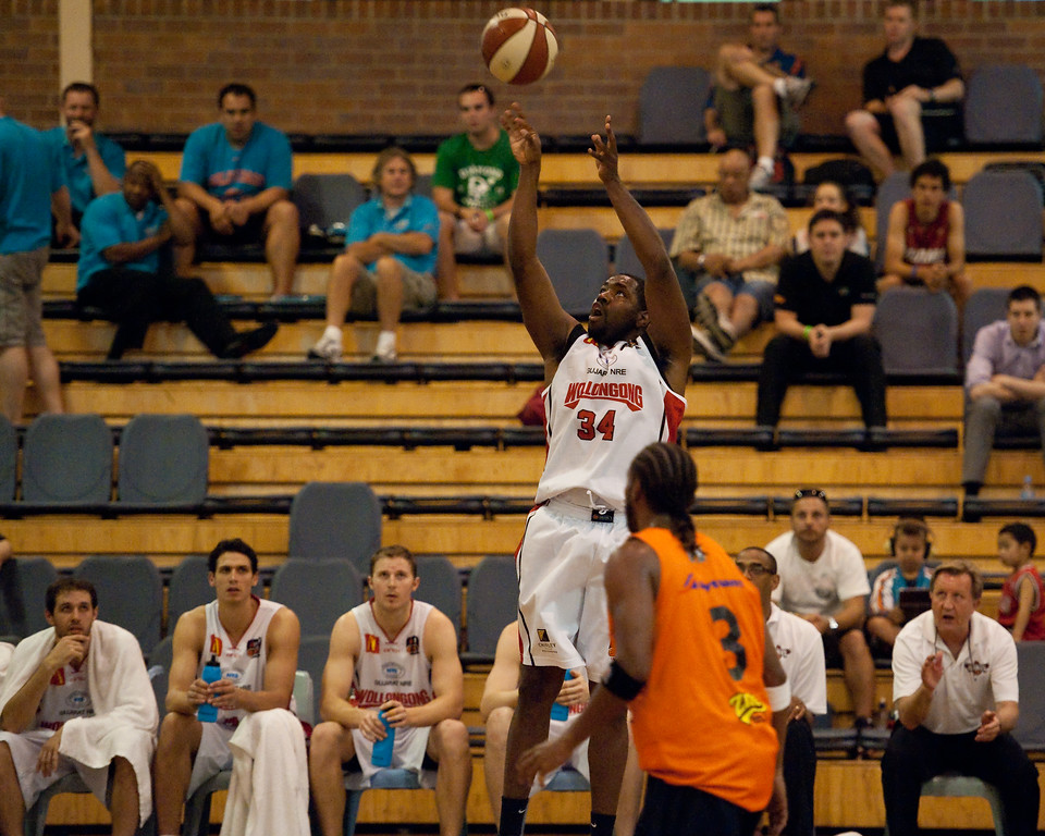 """Joevan Catron - Cairns Taipans v Wollongong Hawks - Sunshine State Challenge Pre-season NBL Basketball, Southport School, Gold Coast, Queensland, Australia; 22 September 2011. Photos by Des Thureson:  <a href=""""http://disci.smugmug.com"""">http://disci.smugmug.com</a>."""