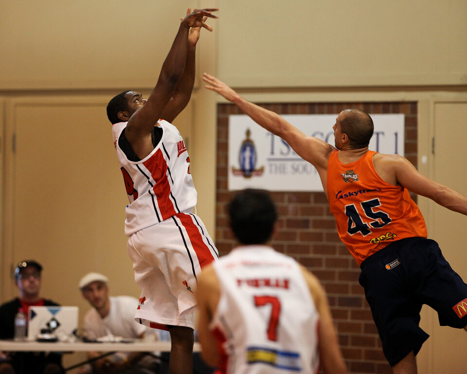"Joevan Catron, Dusty Rychart - Cairns Taipans v Wollongong Hawks - Sunshine State Challenge Pre-season NBL Basketball, Southport School, Gold Coast, Queensland, Australia; 22 September 2011. Photos by Des Thureson:  <a href=""http://disci.smugmug.com"">http://disci.smugmug.com</a>."