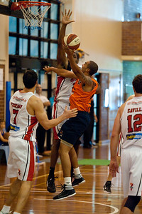 Andrew Warren, Joevan Catron - Cairns Taipans v Wollongong Hawks - Sunshine State Challenge Pre-season NBL Basketball, Southport School, Gold Coast, Queensland, Australia; 22 September 2011. Photos by Des Thureson:  http://disci.smugmug.com.