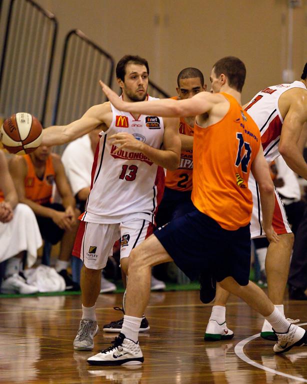 "Rhys Martin, Jeff Dowdell - Cairns Taipans v Wollongong Hawks - Sunshine State Challenge Pre-season NBL Basketball, Southport School, Gold Coast, Queensland, Australia; 22 September 2011. Photos by Des Thureson:  <a href=""http://disci.smugmug.com"">http://disci.smugmug.com</a>."