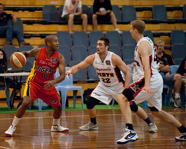 Ayinde Ubaka, Brad Robbins, Shawn Redhage - Melbourne Tigers v Perth Wildcats - Sunshine State Challenge Pre-season NBL Basketball, Southport School, Gold Coast, Queensland, Australia; 22 September 2011. Photos by Des Thureson:  http://disci.smugmug.com.