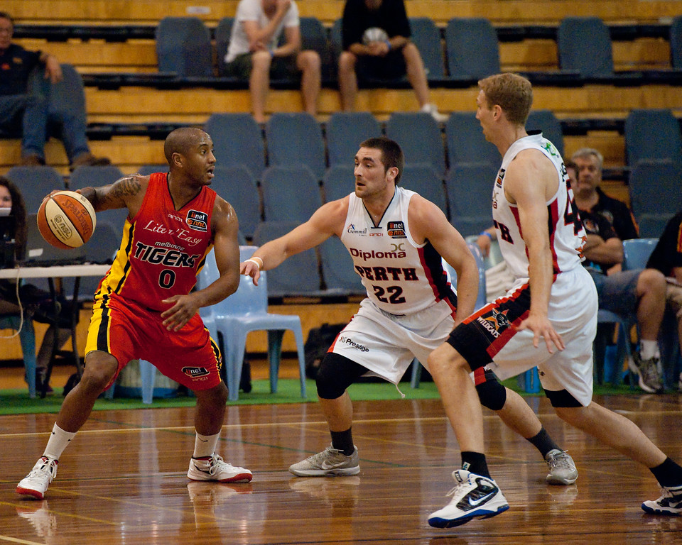 "Ayinde Ubaka, Brad Robbins, Shawn Redhage - Melbourne Tigers v Perth Wildcats - Sunshine State Challenge Pre-season NBL Basketball, Southport School, Gold Coast, Queensland, Australia; 22 September 2011. Photos by Des Thureson:  <a href=""http://disci.smugmug.com"">http://disci.smugmug.com</a>."