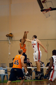 """He shot at the wrong hoop!!"" :) - Tim Coenraad, Andrew Warren - Cairns Taipans v Wollongong Hawks - Sunshine State Challenge Pre-season NBL Basketball, Southport School, Gold Coast, Queensland, Australia; 22 September 2011. Photos by Des Thureson:  http://disci.smugmug.com."