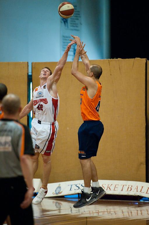 "Dusty Rychart, Dave Gruber - Cairns Taipans v Wollongong Hawks - Sunshine State Challenge Pre-season NBL Basketball, Southport School, Gold Coast, Queensland, Australia; 22 September 2011. Photos by Des Thureson:  <a href=""http://disci.smugmug.com"">http://disci.smugmug.com</a>."