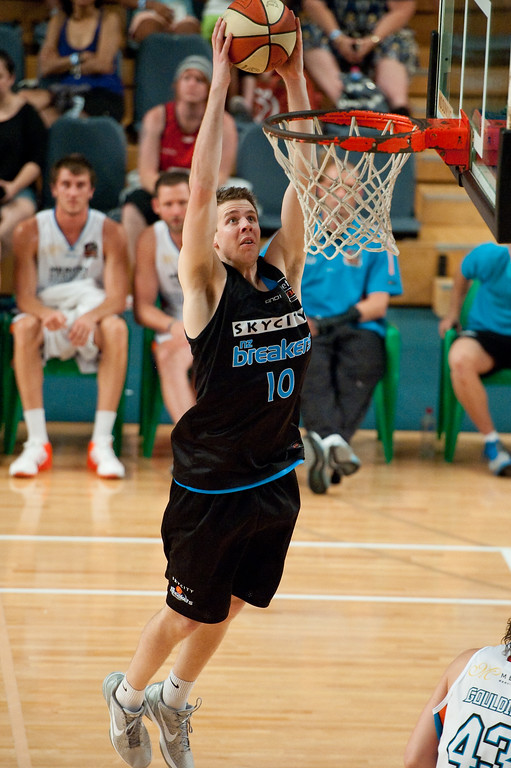 """Thomas Abercrombie with the Slam Dunk - Gold Coast Blaze v New Zealand Breakers - Finals Day, Sunshine State Challenge Pre-season NBL Basketball, Chandler, Brisbane, Queensland, Australia; Saturday 24 September 2011. Photos by Des Thureson:  <a href=""""http://disci.smugmug.com"""">http://disci.smugmug.com</a>."""