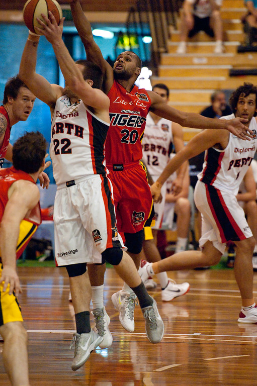 "Patty Mills, Brad Robbins - Melbourne Tigers v Perth Wildcats - Sunshine State Challenge Pre-season NBL Basketball, Southport School, Gold Coast, Queensland, Australia; 22 September 2011. Photos by Des Thureson:  <a href=""http://disci.smugmug.com"">http://disci.smugmug.com</a>."