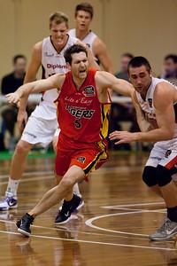 Tom Greer - Melbourne Tigers v Perth Wildcats - Sunshine State Challenge Pre-season NBL Basketball, Southport School, Gold Coast, Queensland, Australia; 22 September 2011. Photos by Des Thureson:  http://disci.smugmug.com.