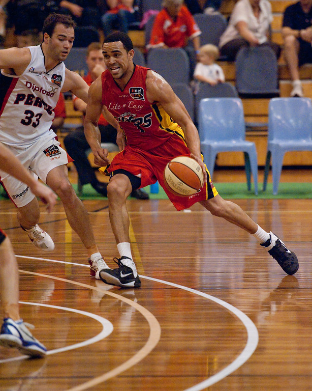 "Daniel Dillon - Melbourne Tigers v Perth Wildcats - Sunshine State Challenge Pre-season NBL Basketball, Southport School, Gold Coast, Queensland, Australia; 22 September 2011. Photos by Des Thureson:  <a href=""http://disci.smugmug.com"">http://disci.smugmug.com</a>."