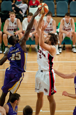 Shot Block on Matthew Knight by Jerai Grant - Grand Final: Perth Wildcats v Sydney Kings - Finals Day, Sunshine State Challenge Pre-season NBL Basketball, Chandler, Brisbane, Queensland, Australia; Saturday 24 September 2011. Photos by Des Thureson:  http://disci.smugmug.com.