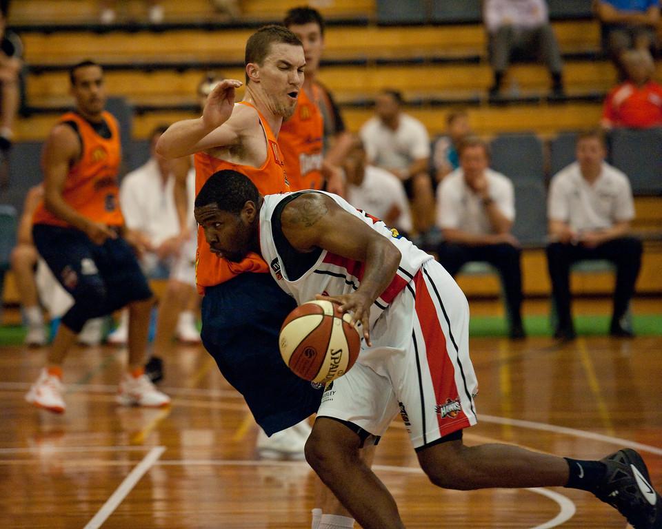 "Jeff Dowdell, Joevan Catron - Cairns Taipans v Wollongong Hawks - Sunshine State Challenge Pre-season NBL Basketball, Southport School, Gold Coast, Queensland, Australia; 22 September 2011. Photos by Des Thureson:  <a href=""http://disci.smugmug.com"">http://disci.smugmug.com</a>."