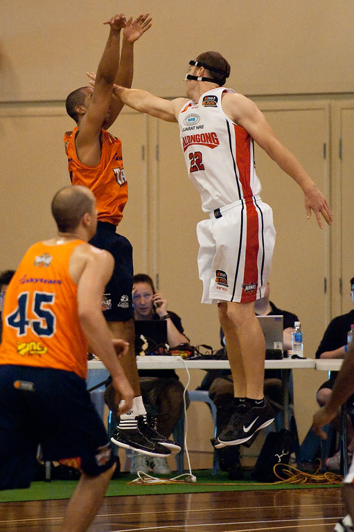 "Tim Coenraad, Andrew Warren - Cairns Taipans v Wollongong Hawks - Sunshine State Challenge Pre-season NBL Basketball, Southport School, Gold Coast, Queensland, Australia; 22 September 2011. Photos by Des Thureson:  <a href=""http://disci.smugmug.com"">http://disci.smugmug.com</a>."