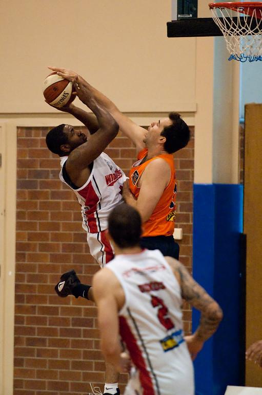 "Shot Block - Joevan Catron, Ian Crosswhite - Cairns Taipans v Wollongong Hawks - Sunshine State Challenge Pre-season NBL Basketball, Southport School, Gold Coast, Queensland, Australia; 22 September 2011. Photos by Des Thureson:  <a href=""http://disci.smugmug.com"">http://disci.smugmug.com</a>."