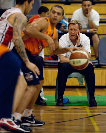 "Wollongong Hawks Head Coach Gordie McLeod encourages the defence - Cairns Taipans v Wollongong Hawks - Sunshine State Challenge Pre-season NBL Basketball, Southport School, Gold Coast, Queensland, Australia; 22 September 2011. Photos by Des Thureson:  <a href=""http://disci.smugmug.com"">http://disci.smugmug.com</a>."