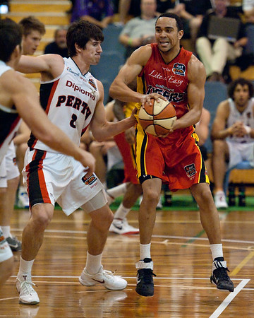 """Melbourne Tigers v Perth Wildcats - Sunshine State Challenge Pre-season NBL Basketball, Southport School, Gold Coast, Queensland, Australia; 22 September 2011. Photos by Des Thureson:  <a href=""""http://disci.smugmug.com"""">http://disci.smugmug.com</a>."""
