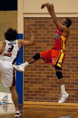 "Melbourne Tigers v Perth Wildcats - Sunshine State Challenge Pre-season NBL Basketball, Southport School, Gold Coast, Queensland, Australia; 22 September 2011. Photos by Des Thureson:  <a href=""http://disci.smugmug.com"">http://disci.smugmug.com</a>."