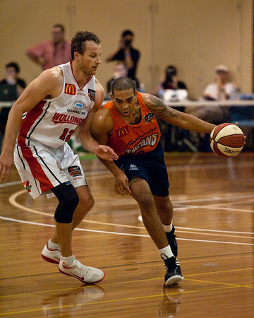 """Cairns Taipans v Wollongong Hawks - Sunshine State Challenge Pre-season NBL Basketball, Southport School, Gold Coast, Queensland, Australia; 22 September 2011. Photos by Des Thureson:  <a href=""""http://disci.smugmug.com"""">http://disci.smugmug.com</a>."""
