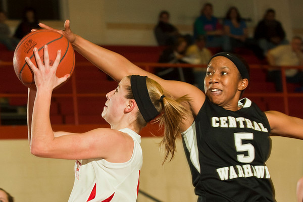 Westerville South High School's Erica Aiello (5) tries to get two points past Westerville Central High School's Tabbytha Walker (5) in the first period of play at Westerville South High School Saturday night January 22, 2011.