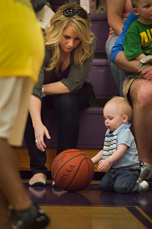 10 month old spectator Caden Cracraft plays with a basketball in the lap of Greg Ewing before the Harlem Wizards took on the Reynoldsburg-Pickerington Community All-Stars at the Reynoldsburg High School gymnasium Thursday evening April 14, 2011.  The game was presented by the Reynoldsburg-Pickerington Rotary Club as a fund raiser. (© James D. DeCamp | 614-462-8027 | http://www.OhioPhotojournalist.com)