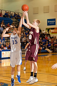 New Albany High School's Jack Serbin (40) shoots past Olentangy Liberty High School's Nick Archer (35) in the first quarter of play Saturday evening December 3, 2011 at Olentangy Liberty High School.  (© James D. DeCamp | http://www.JamesDeCamp.com | 614-367-6366)