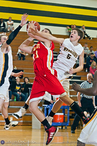 Watkins Memorial High School's Devin Backer (23), left, and Taylor Foss (5) try to block Big Walnut High School's Seth Myers in the first quarter of play Tuesday night, December 6, 2011 at Watkins Memorial High School.  (© James D. DeCamp | http://www.JamesDeCamp.com | 614-367-6366)