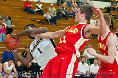 Watkins Memorial High School's  LeTrel Taylor (1) pulls in a rebound against Big Walnut High School's Seth Myers (11) in the first quarter of play Tuesday night, December 6, 2011 at Watkins Memorial High School.  (© James D. DeCamp | http://www.JamesDeCamp.com | 614-367-6366)
