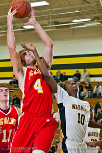 Watkins Memorial High School's Aarmanni Garnett (10) tries to block two points by Big Walnut High School's Seth Wandling in the second quarter of play Tuesday night, December 6, 2011 at Watkins Memorial High School.  (© James D. DeCamp | http://www.JamesDeCamp.com | 614-367-6366)