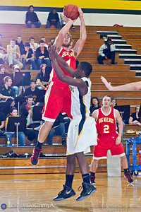 Big Walnut High School's Seth Wandling (4) shoots over Watkins Memorial High School's LeTrel Taylor (1) in the first quarter of play Tuesday night, December 6, 2011 at Watkins Memorial High School.  (© James D. DeCamp | http://www.JamesDeCamp.com | 614-367-6366)