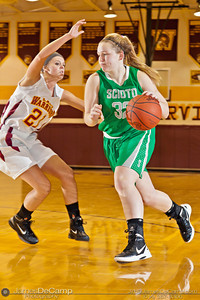 Dublin Scioto High School's Katie Kollins (32) makes her way around Westerville North High School's Maddy Roseberry (21) in the second quarter of play Friday night December 16, 2011 at Westerville North High School.  (© James D. DeCamp | http://www.JamesDeCamp.com | 614-367-6366)