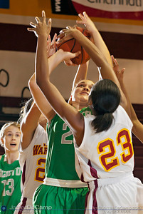 Dublin Scioto High School's Casey Suich (21) tries for two around the hands of Westerville North High School's Maddy Roseberry (21), rear, and Symone Simmons (23) in the second quarter of play Friday night December 16, 2011 at Westerville North High School.  (© James D. DeCamp | http://www.JamesDeCamp.com | 614-367-6366)