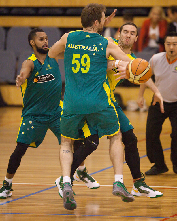 "Patty Mills (L) along with former Gold Coast Blaze team mates Mark Worthington (middle) & Adam Gibson (R) - Boomers - Australian Men's Basketball Team Open Training Session, The Southport School, Gold Coast, Queensland, Australia; 12 July 2012. Photos by Des Thureson:  <a href=""http://disci.smugmug.com"">http://disci.smugmug.com</a>."