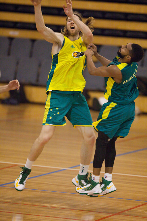 "Mid air contest between David Barlow & Patty Mills - Boomers - Australian Men's Basketball Team Open Training Session, The Southport School, Gold Coast, Queensland, Australia; 12 July 2012. Photos by Des Thureson:  <a href=""http://disci.smugmug.com"">http://disci.smugmug.com</a>."