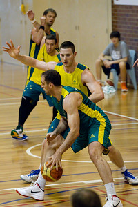 Aleks Marić, Aron Baynes (note Adam Gibson receiving the 'nice' chicken wing from David Andersen in the background :) ) - Boomers - Australian Men's Basketball Team Open Training Session, The Southport School, Gold Coast, Queensland, Australia; 12 July 2012. Photos by Des Thureson:  http://disci.smugmug.com.
