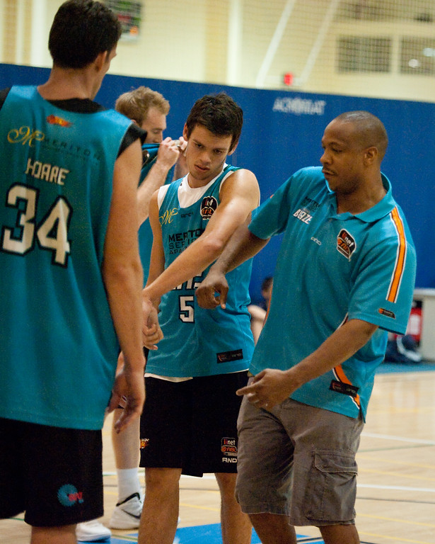 "Gold Coast Blaze Head Coach Joey Wright instructs second year point guard Jason Cadee - Gold Coast Blaze Basketball Open Training Session; Boondall, Brisbane, Queensland, Australia; 18 February 2012. Photos by Des Thureson - <a href=""http://disci.smugmug.com"">http://disci.smugmug.com</a>."