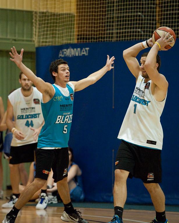 """Jason Cadee puts the D on Gibbo - Gold Coast Blaze Basketball Open Training Session; Boondall, Brisbane, Queensland, Australia; 18 February 2012. Photos by Des Thureson - <a href=""""http://disci.smugmug.com"""">http://disci.smugmug.com</a>."""