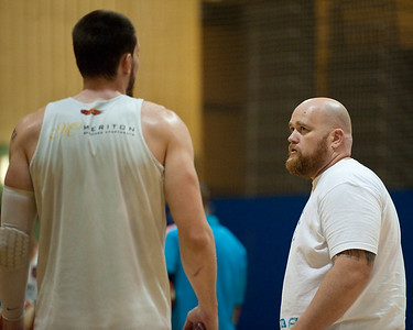 Blaze Centre Will Hudson in discussion with Blaze Assistant Coach Mick Conlon. - Gold Coast Blaze Basketball Open Training Session; Boondall, Brisbane, Queensland, Australia; 18 February 2012. Photos by Des Thureson - http://disci.smugmug.com.