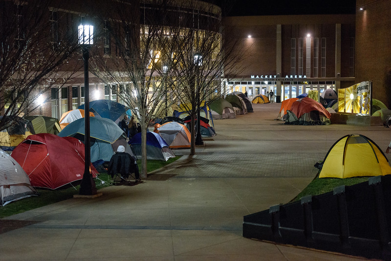 Members of the Paint Crew camp out to reserve their spots in line the night before the game.