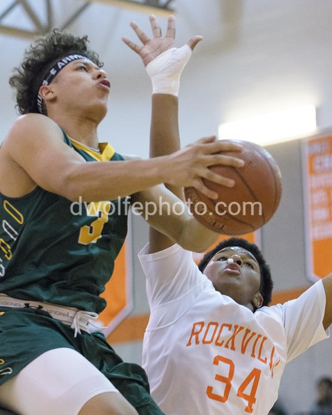 Seneca Valley's Brandon Simpson drives the lane guarded by Rockville's Jeffrey Gomez for 2 points.
