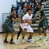 Jeffrey Gomez holds tight to the ball as he looks for a way past three Seneca Players who blocked him in.