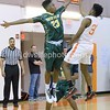 Seneca's Moe Whitsett blocks a shot attempt by Rockville's Steve Chaney.